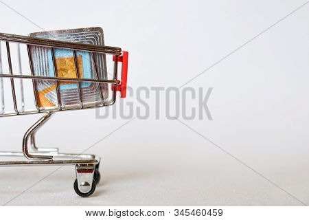 Rfid Tag In A Supermarket Trolley. Shoplifting Prevention. Goods Security And Alarm. Light Backgroun