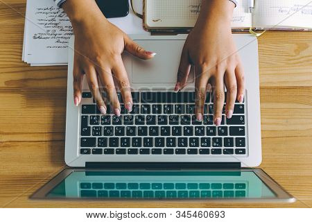 Topview Flat Lay Of Business Working Place With Laptop, Phone And Woman Hands Typing.
