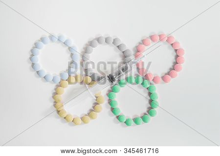 Concept Of Doping In Big Sport Or Olympic Games. Sign Of The Olypic Games Laid Out With Pills And A