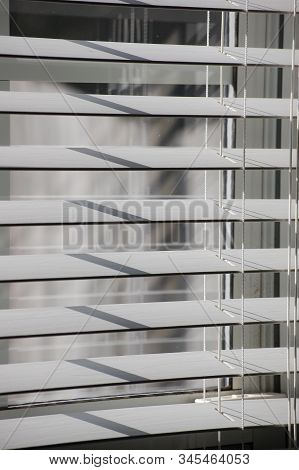 White Horizontal Faux Window Blinds In Open Position