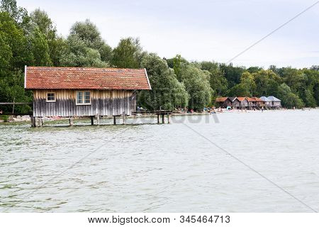 Wooden Cottage On Pier On The Lake Ammersee In Inning Am Ammersee, Germany