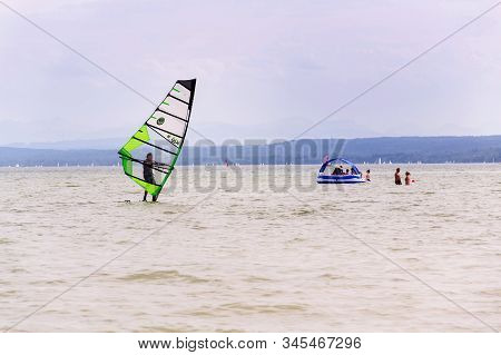 Inning Am Ammersee, Germany - July 6 2019: Man Windsurfing On The Lake Ammersee On July 6, 2019 In I