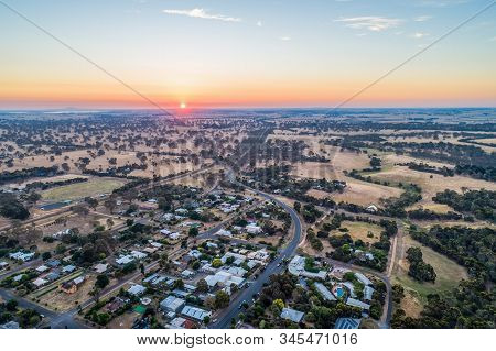 Rural Road Winding Through Pastures And Small Town In Australian Countryside - Aerial Panorama