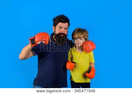 Sportswear Fashion. Parenthood Relationship. Bearded Sports Man Coaching Boxing Little Boy In Red Bo