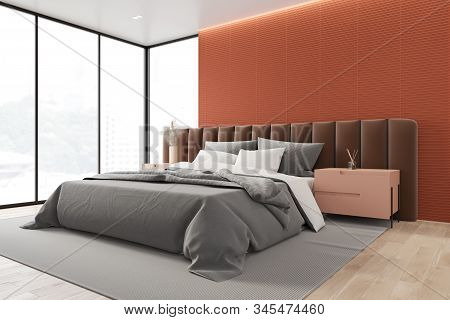 Orange Master Bedroom Corner With Brown Bed