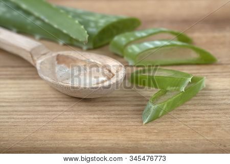Aloe Vera Leaf Cut Into Pieces. Transparent Aloe Vera Jelly On Wooden Spoon