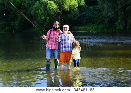 Three Generations Ages: Grandfather, Father And Young Teenager Son. Coming Together. Fly Fishing. Gr