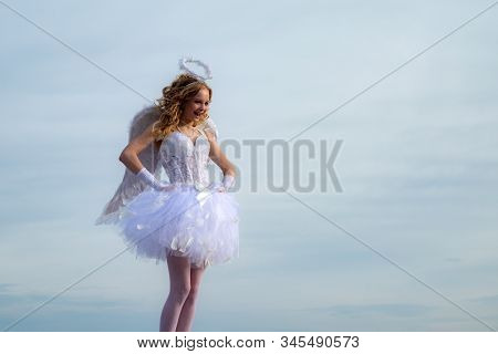 Cherub Girl. Little Girl With Angel Wings And Halo. Bow And Arrow. Cupid Cute Girl With A Bow. Space