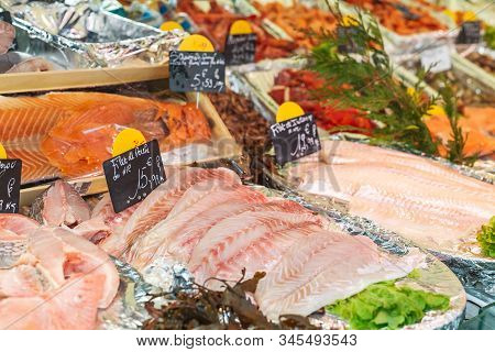 Raw Perched Fish Fillet At The Fish Market With Price Tags. Large Assortment Of Fresh Chilled Seafoo