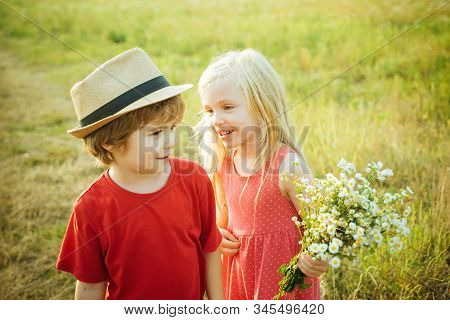 Beautiful Little Couple - Boy And Girl Embracing. Childhood Concept. Summer Portrait Of Happy Cute C