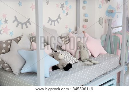 Kids Bed In White Sunny Bedroom. Children Room And Interior Design. Bed For Baby Or Toddler Boy At H