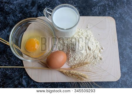Ingredients For Cooking Flour Products Or Dough. Flour, Egg, Milk Close Up. Top View. Copy Space