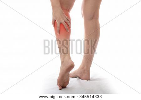 Woman With Calf Feeling Pain On White Background, Women Suffering From Pain In The Leg
