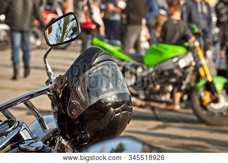 Motorcycle Steering Wheel Closeup. Chrome Steering Wheel Elements. Motorcycle Protective Helmet