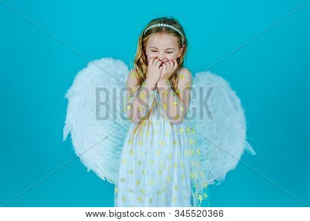 Valentines Day. Looks Like An Angel. Angel Kid With Blonde Curly Hair. Cute Child Girl In White Dres