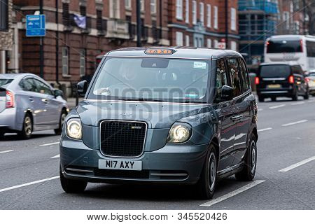 London, England, Uk - December 31, 2019:   Typical Black London Cab In City Streets. Traditionally T