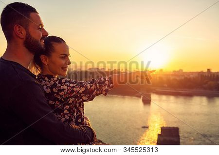 Smiling Couple In Love At Sunset Enjoying Time Together.