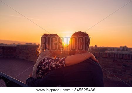 Enjoying Time Together. Young Couple Hugging At Evening