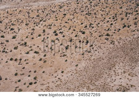 Arid Savanna Aerial Background With Bushes And Trees On An Arid Plain, An Abstract Drone Shot With C