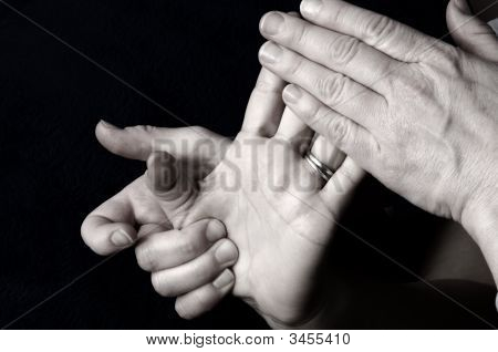 Massaging Hand Palm And Fingers