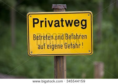 Private Ground Sign Warning In German Language Text Translation