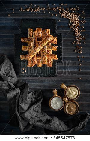 Feta Cheese Crackers With Poppy Seeds As Decoration