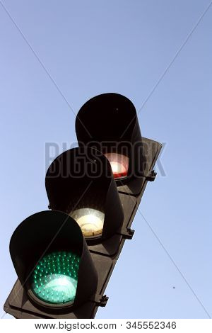 Isolated Traffic Light Over Clear, Blue Sky
