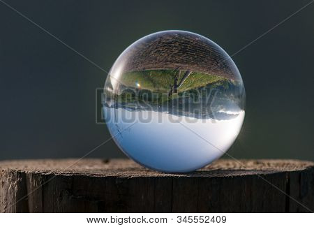 Glass Ball On The Forrest Background. Zen-like And Meditation Concept