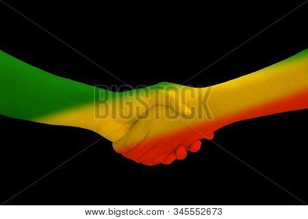 Green Yellow Red On Human Hand Reggae Background Concept
