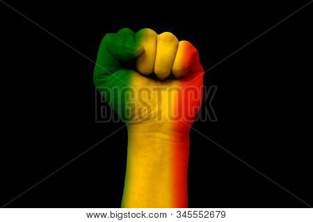 Green Yellow Red On Human Hand,reggae Background Concept