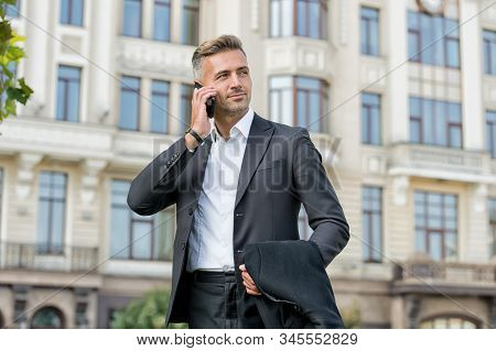 Phone Keeps Him Connected. Businessman Talk On Mobile Phone. Handsome Man With Cell Phone Outdoor. P