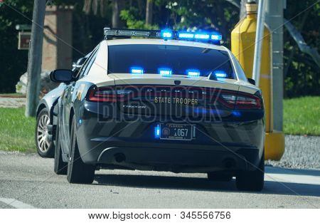 Miami, Fl, U.s.a - January 3, 2020 - The Florida State Trooper Stopping A Driver On The Highway