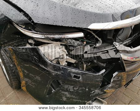 Damaged Car with Dents from the Accident, Car after an Head on Collision
