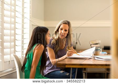 Teacher Helping Her Student With Her Homework