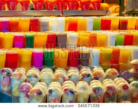 Vegetables And Fresh Fruits Cutted Into Pieces In Plastic Cups On Market Shelves, Close Up View. Mul