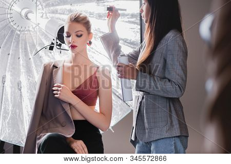 Selective Focus Of Hairstylist Doing Hairstyle To Stylish Model On Backstage