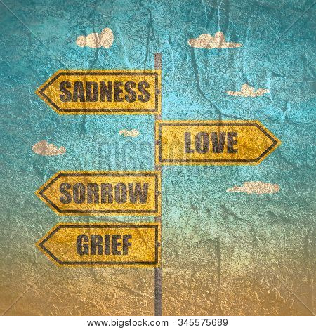 Road Signs With Sadness, Sorrow, Grief And Love Words Pointing In Opposite Directions.