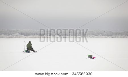 Winter Fishing On Ice, Natural Background.fishermen On The Lake.