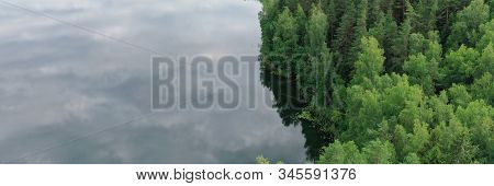 Topview Of Wood And Riverside. Horizon Dividing Cloudy Sky And Green Wild Nature. Landscape Of Valle