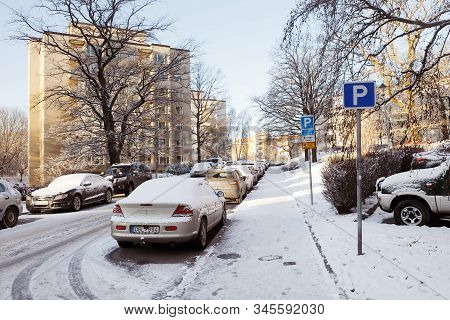 Solna, Sweden - December 10, 2019: Parked Cars At The Snow Covered Street Virebergsvagen.