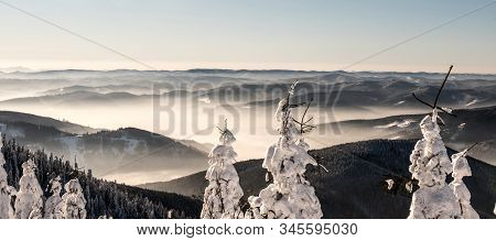 Mountain Panorama With Many Mountain Ranges, Mist And Clear Sky Above From Hiking Trail Bellow Lysa