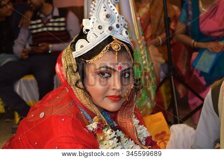 Midnapur, India - February 6, 2019: Indian Bride In Traditional Hindu Wedding Red Sari And Gold Jewe