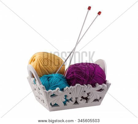 Yellow, Blue, Violet Clews For Hand Knitting In White Wooden Basket. Isolate