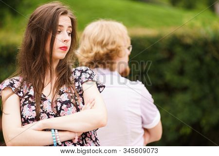 Offended Upset Couple Young Male And Female Not Talking To Each Other Sitting Back To Back After Arg