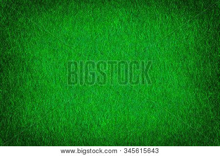 Bright Green Matte Background Of Suede Fabric, Closeup. Texture Of Seamless Emerald Woolen Felt