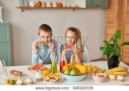 Children Eat Fruit Pineapple, Watermelon, Apples And Drink Drinks With Chia. Healthy Food In The Chi