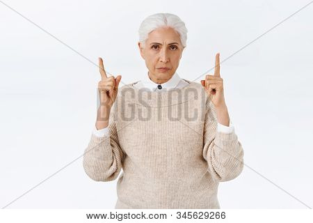 Disappointed, Angry Gloomy Senior Lady With Grey Combed Hair, Frowning And Sulking, Pointing Fingers