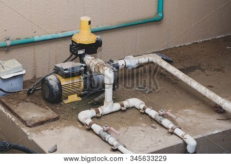 Water Pump Plumbing And Pvc Pipes Exterior Set-up In A Home. Diy, Repair, Plumbing Concepts.