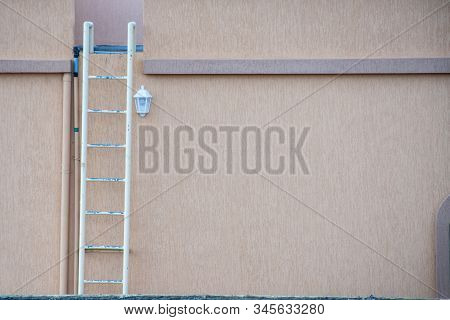 White Fire Escape Ladder On The Exterior Of A Residential House In The United Arab Emirates In The M