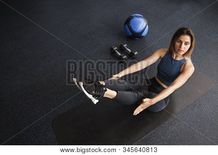Upper-angle Shot Motivated Young Female Athlete, Sportswoman Workout In Gym, Lying Rubber Mat Near M